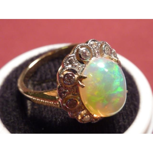 307 - An 18 carat gold large opal and diamond cluster Ring...