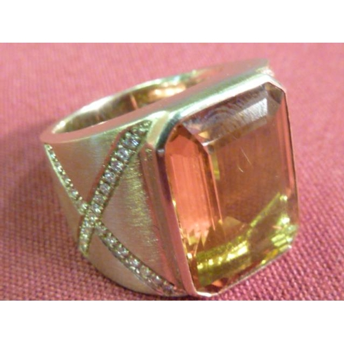308 - A very heavy (25g) 18 carat gold Imperial topaz and diamond Ring...