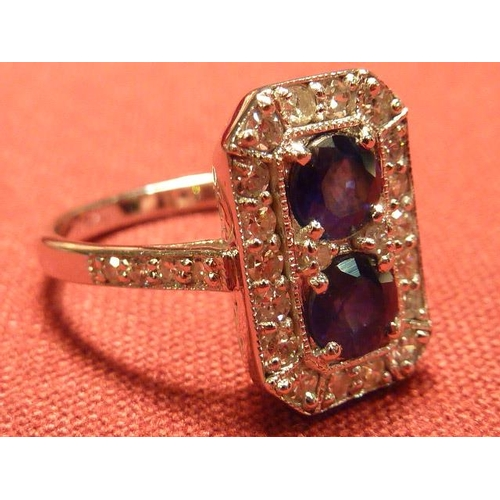 310 - An Art Deco style 18 carat white gold sapphire and diamond Ring...