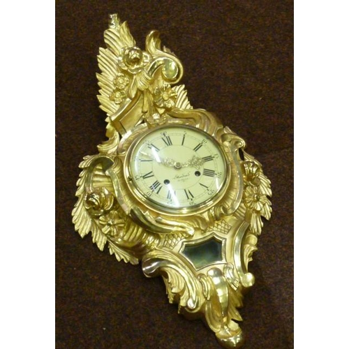 312 - A fine carved gilt wood Swedish Cartel Clock, the pediment with leaves and flowers above a 16cm crea...
