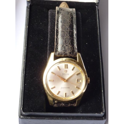 317 - A gentleman's Omega Seamaster Automatic Wristwatch, the mother of pearl style dial with baton marker...