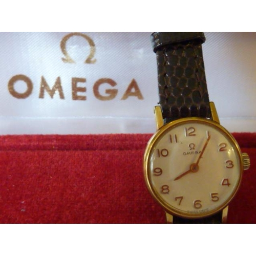 321 - A ladies Omega Wristwatch, the signed dial with Arabic numerals, on crocodile effect leather strap, ...