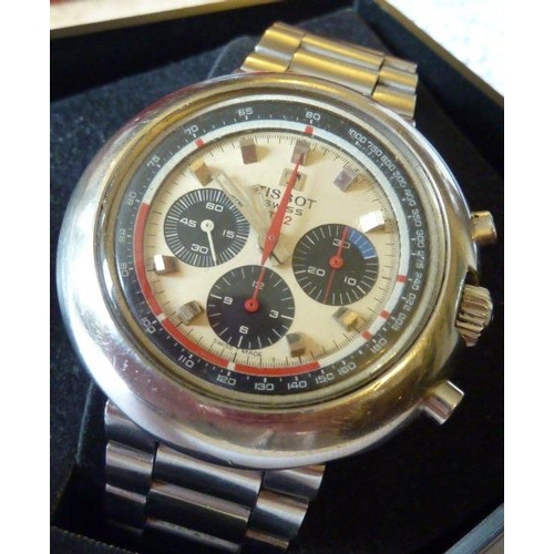 323 - A gentleman's boxed Tissot Swiss T 12 steel cased multi-dial Wristwatch, the dial with internal incr...