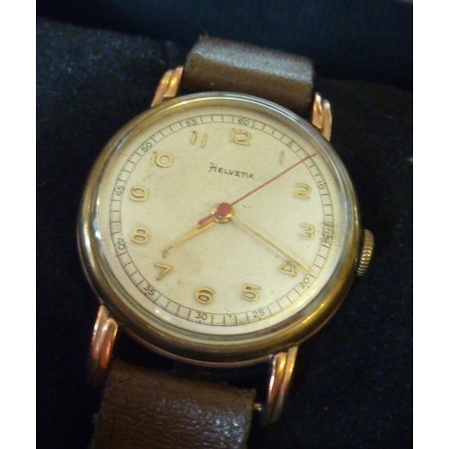 324 - A 9 carat rose gold backed Wristwatch, the dial signed Helvetia, with Arabic numerals and on brown l...