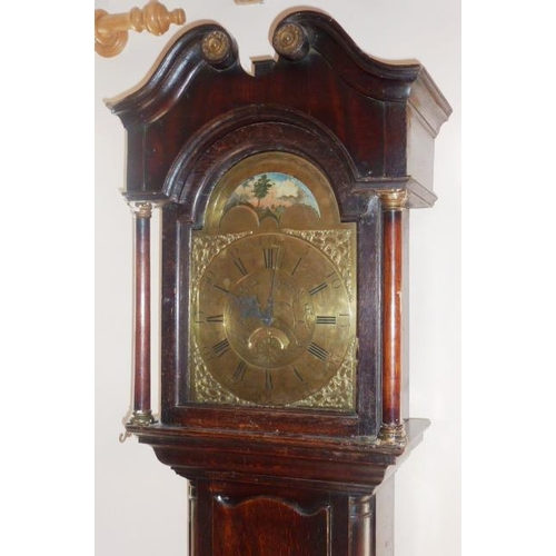 329 - A George III period oak and mahogany Longcase Clock, the broken swan neck pediment above a 12'' brok...