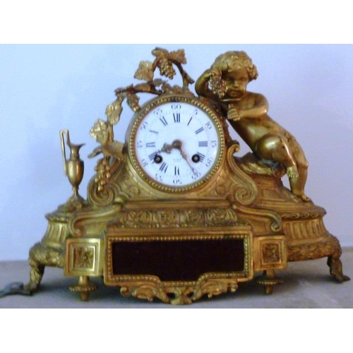 330 - A 19th Century gilt metal eight-day Mantel Clock, the cherubic figure with grapes and a glass above ...