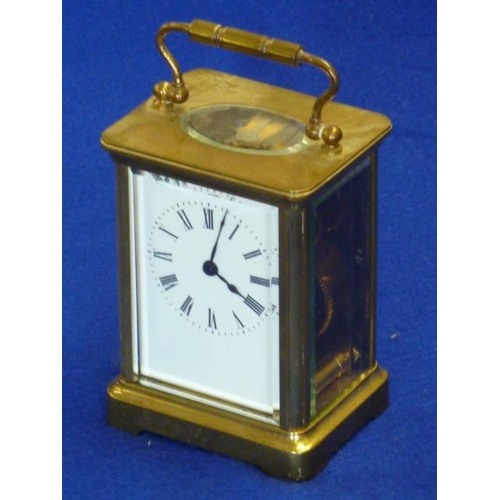 331 - An early 20th Century brass and glass sided Carriage Clock, white enamel dial with Roman numerals (w...