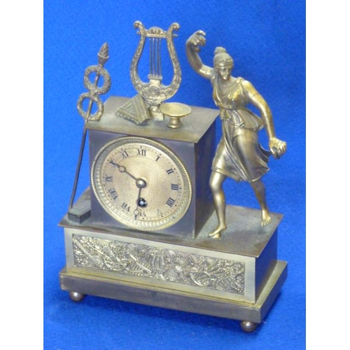 332 - A French Empire period ormolu mounted figural Mantel Clock, the engraved dial with Roman numerals an...