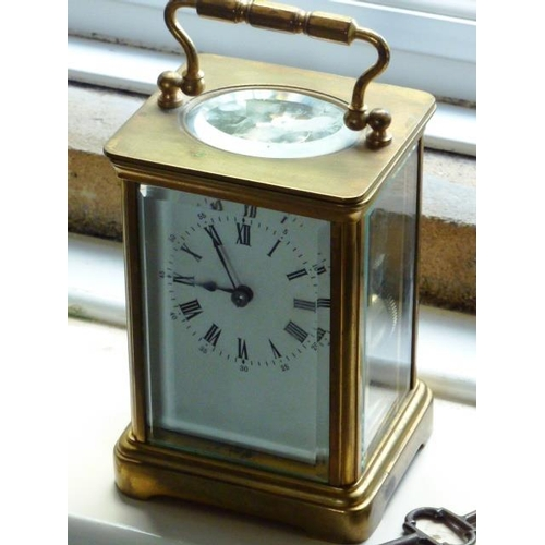 335 - An early 20th Century brass and glass sided Carriage Clock, white enamel dial with Roman numerals, t...