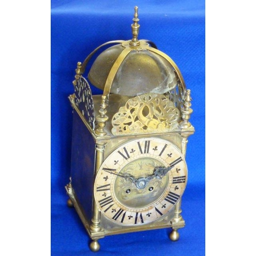 336 - A 17th Century style brass Lantern Clock (probably early 20th Century), the central urn shaped finia...