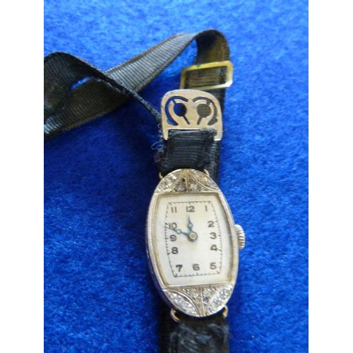 338 - A ladies 18 carat white gold cased Dress Wristwatch, the dial with Roman numerals and the movement s...
