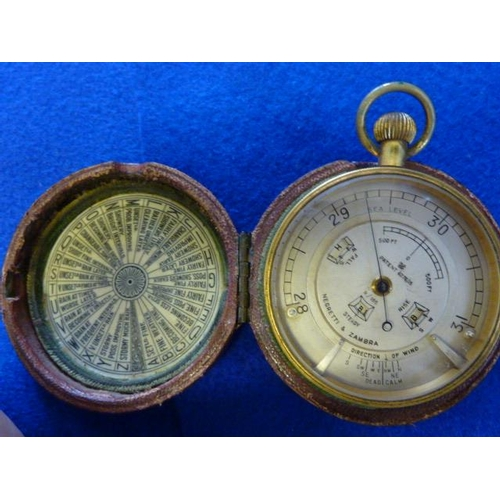 340 - A good 19th Century leather cased Travelling Barometer, the complex silver dial signed Negretti & Za...