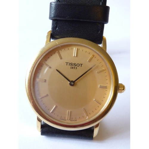 343 - A gentleman's Tissot dress Wristwatch the gold coloured dial (signed) with baton markers and having ...
