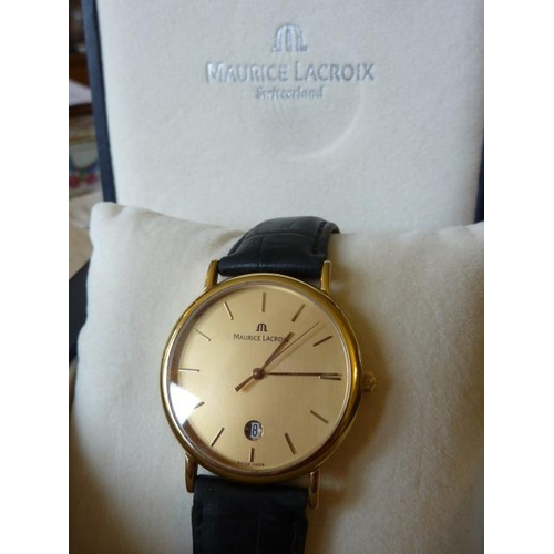 344 - A boxed Maurice Lacroix gentleman's dress Wristwatch, the gold coloured dial with baton markers and ...