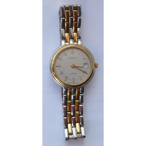 348 - A ladies steel and gold plated Wristwatch, the rotating blue enamel bezel surrounding a cream dial w...