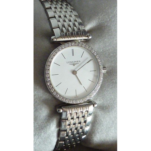 350 - A ladies fine boxed Longines Dress Wristwatch, stainless steel bracelet (with three extra links), wh...