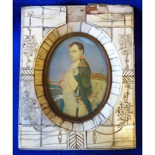 369 - A reproduction oval Portrait Miniature of Napoleon within a tooled bone frame, the Portrait 8.5cm hi...