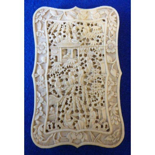 371 - A very intricately carved 19th Century Chinese ivory Card Case depicting figures, buildings, flowers...