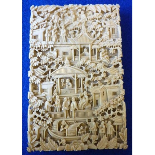 372 - A 19th Century rectangular Chinese ivory Card Case intricately carved with a profusion of buildings,...