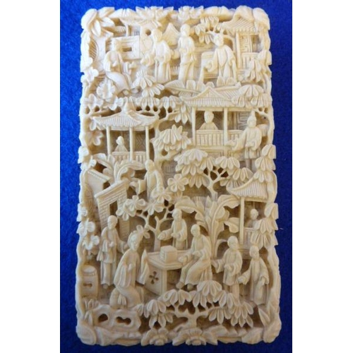 373 - An intricately carved 19th Century Chinese ivory Card Case decorated with various figures, buildings...
