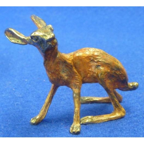 375 - A cold painted Bronze Hare, 6cm long...