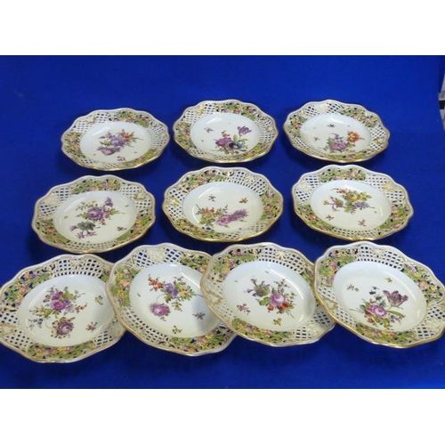 38 - A set of ten 19th Century Dresden style porcelain Cabinet Plates, each with gilded shaped reticulate...