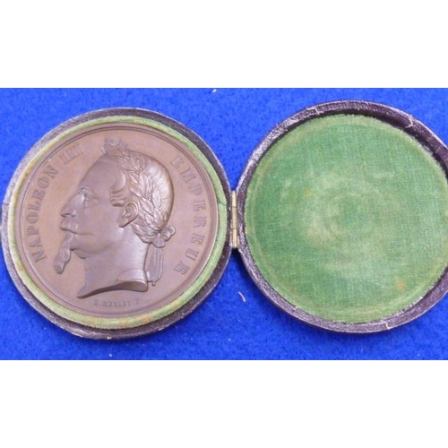 382 - A 19th Century cased circular patinated bronze Medallion depicting the head of Napoleon III, signed ...
