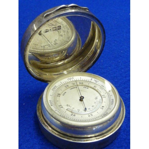 385 - An unusual Edwardian hallmarked silver cased circular Travelling Barometer, assayed London 1907...