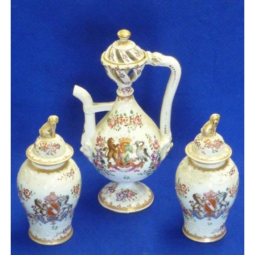 39 - A late 19th Century Samson porcelain armorial Ewer together with two further smaller baluster-shaped...