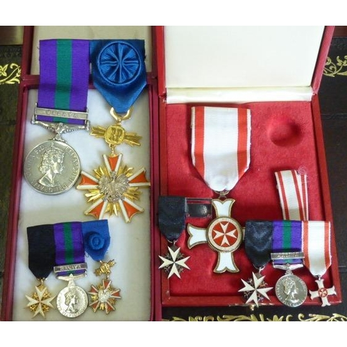 391 - An interesting group of Medals and Crosses comprising a cased Cross of Merit (the Order of St John o...