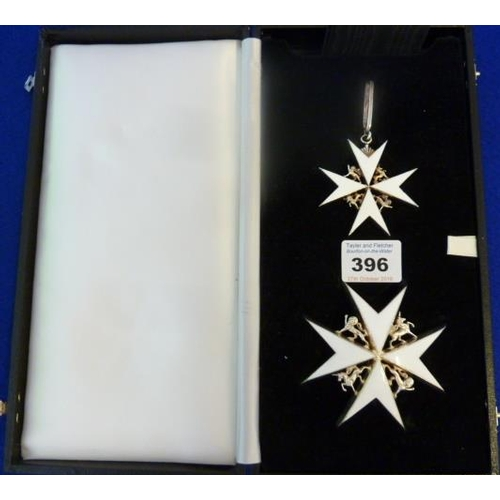 396 - The Most Venerable Order of St John, cased Knight of Grace's set of insignia comprising a white meta...