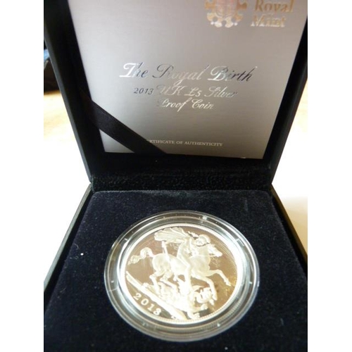 411 - A boxed 5 Pound silver proof Coin commemorating the royal birth 2013, together with paperwork...