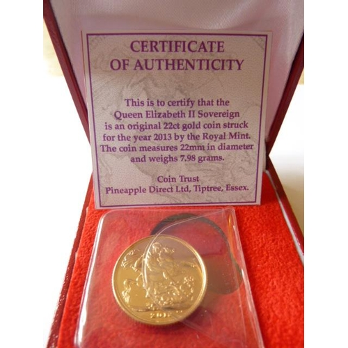 416 - A boxed 2013 UK gold Sovereign...