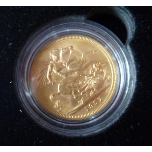 422 - A boxed Elizabeth II gold Sovereign dated 1957...