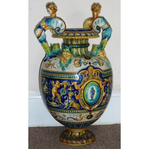 46 - A very large 19th Century two-handled Maiolica Vase, the two caryatid style winged female figures ab...