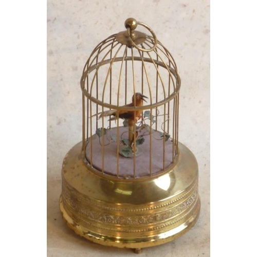 460 - A circa 1900 German singing bird Automaton in gilt brass cage, good working order...