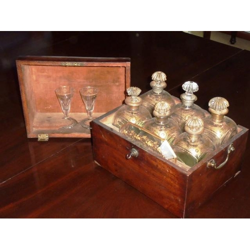 471 - A fine 19th Century mahogany cased Decanter Set comprising six Decanters with gilt highlights, an oc...