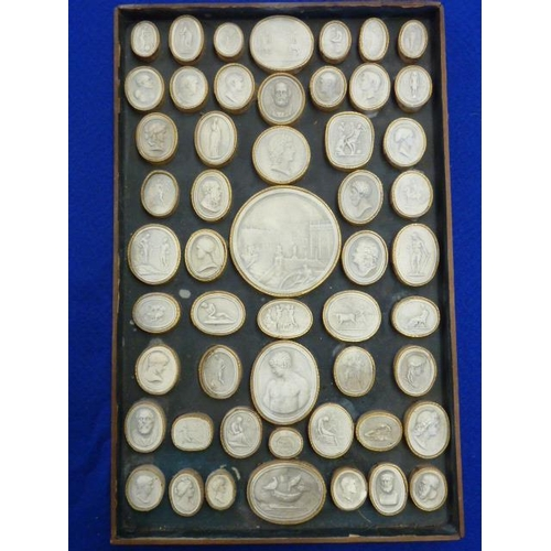 481 - Approximately 52 19th Century Grand Tour Portrait style Intaglios within a frame, frame size 33cm x ...