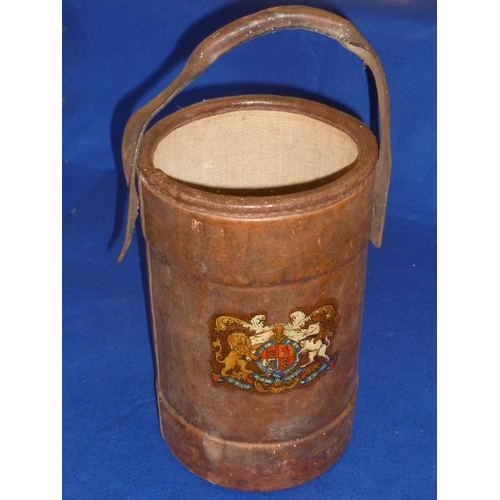 482 - A First World War cylindrical brown leather Munitions Carrier decorated with the Royal Crest, 33.5cm...