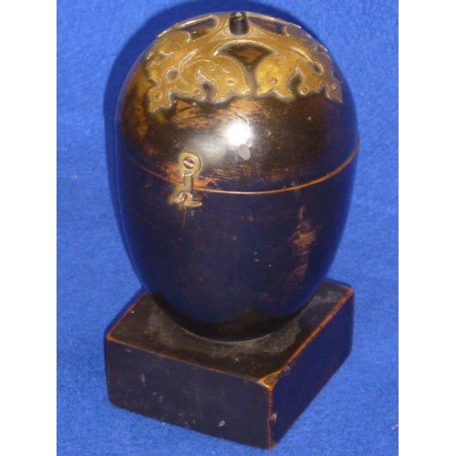 483 - An unusual 19th Century ebonised and brass mounted Treen Tea Caddy (possibly modelled as a melon?), ...