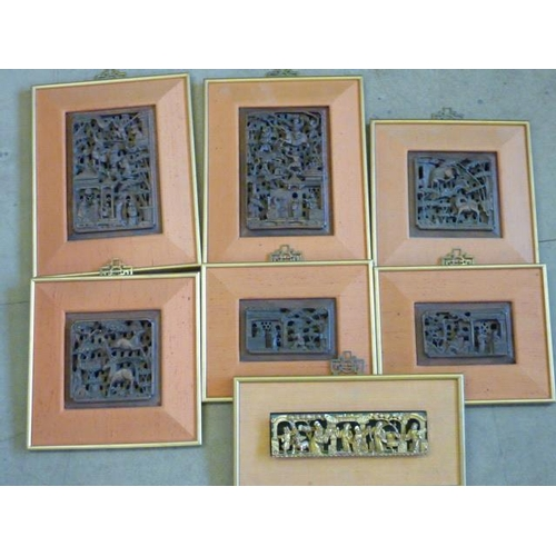 486 - Seven gilt framed and orange mounted Chinese decorative wooden Carvings of various sizes (one Carvin...