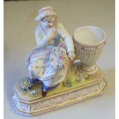 49 - A 19th Century Continental hand decorated porcelain Figure, young girl in bonnet with flowers sat ne...