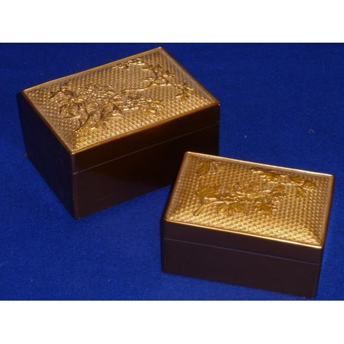 494 - Two (one larger, one smaller) Japanese gilt lacquer oblong Boxes and Cover, the lids decorated in re...