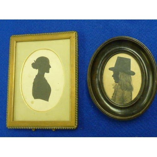499 - A 19th Century oval ebonised Portrait Silhouette of a young boy in top hat together with one other l...