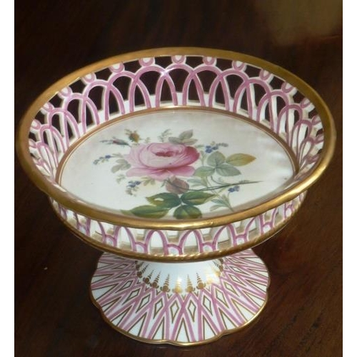 5 - A 19th Century Continental porcelain Comport, the arched pierced gallery above a floral vignette of ...