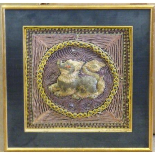 505 - A framed Chinese Needle Stitch in relief depicting a Qilin, 28.5cm square...