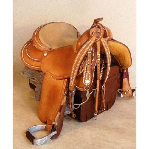 509 - A very fine unique hand stitched leather and rhinestone Western Show Saddle, breast plate and stall ...