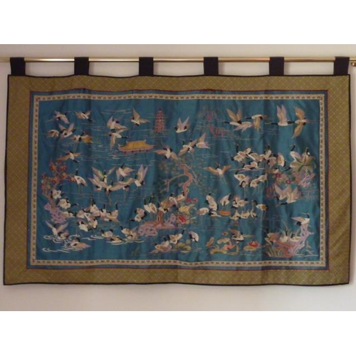 513 - A very fine Japanese silkwork Wall Hanging decorated with a central pine tree and a profusion of cra...