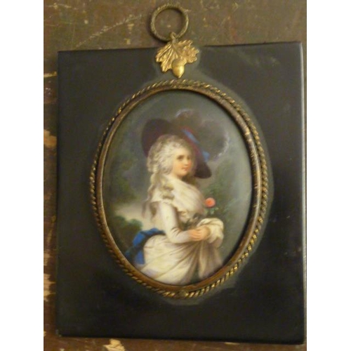 519 - A 19th Century oval shoulder length Portrait Miniature of a beautiful young lady with long curly gre...