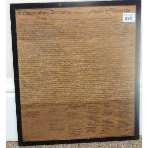 522 - An ebonised framed and glazed reproduction Parchment ''The Unanimous Declaration of The Thirteen Uni...
